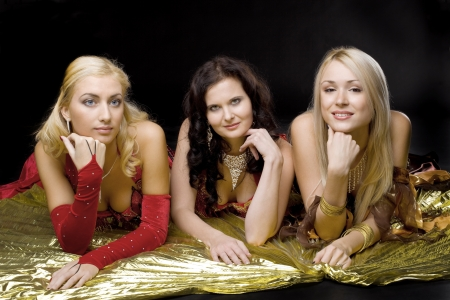 Three young beauty  woman  on gold wing photo