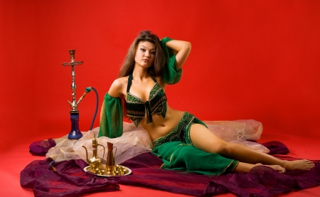 harem: beauty young woman with hookah on veil in red Stock Photo