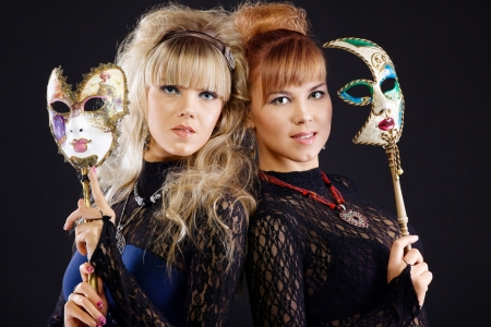 Two beauty sisters with venice mask photo