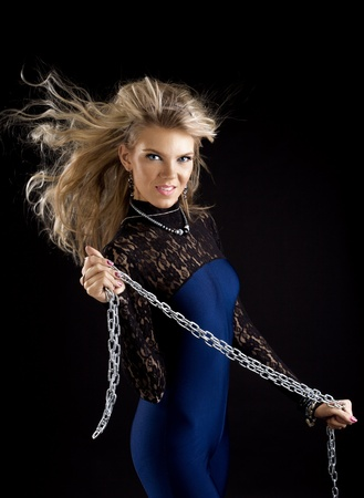 Beauty girl with chain and fly hairs photo