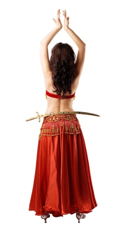 Woman in arabic red costume with saber at hip photo
