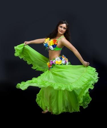 brazilian ethnicity: Beauty mature woman dance in green carnival costume Stock Photo