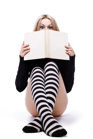 young woman hide above book Stock Photo - 12936562