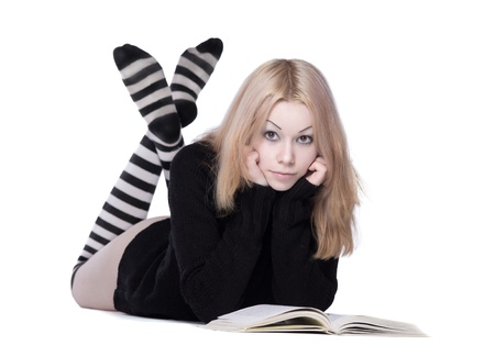 young woman lay with book with naked leg photo