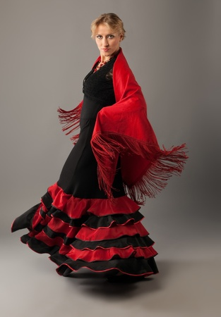 Beauty woman dance flamenco in black and red costume photo