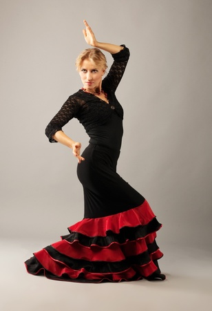 Beauty mature woman dance flamenco studio shot photo