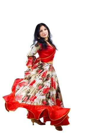 Volwassen vrouw dans in zigeuner kostuum geïsoleerd Stockfoto