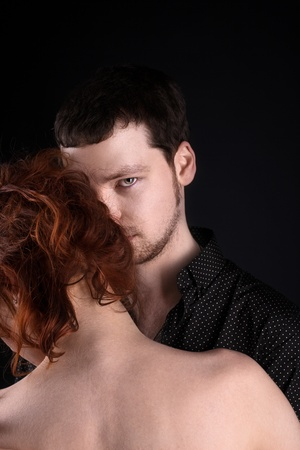 Man and red woman - closeup lovers portrait Standard-Bild
