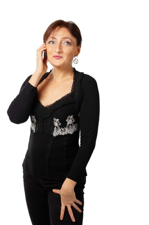 Mature woman in lace jacket tell on cell phone and smile photo