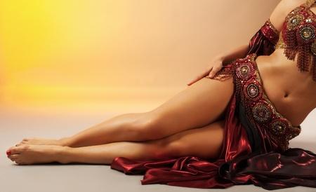 Beauty arabian dancer legs in traditional costume