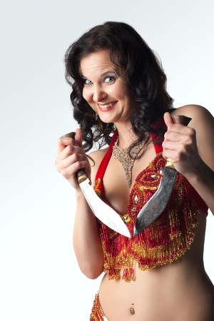 Insane smiling  woman in arabian costume with knife photo