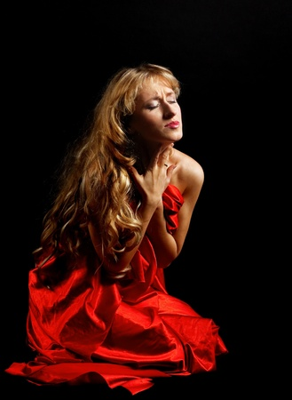 performance art: Blond woman in red with gold hair - tragedy role