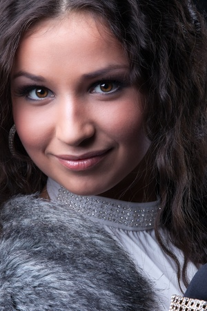 Pretty girl close-up portrait in fur coat photo