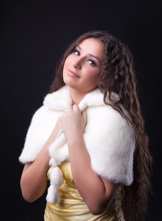 Young pretty girl close-up portrait in white fur coat Stock Photo - 8872420