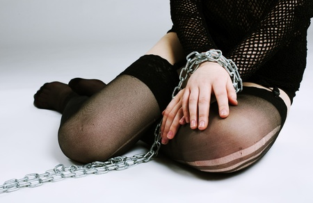 Young girl in chain on hands - fetish games Stock Photo - 8872431