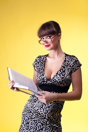 Beauty woman in attractive dress and glasses read smart book Stock Photo - 8872418