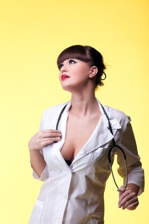 Sexy nurse pinup style with stethoscope in love Stock Photo - 8872415