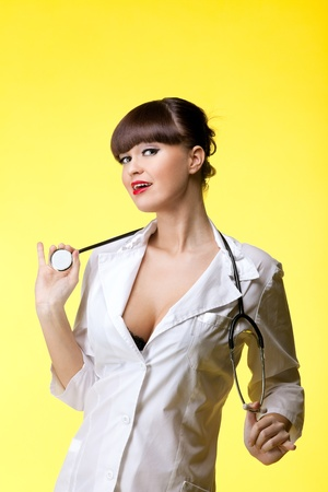 Attractive woman in nurse costume with stethoscope - pinup Stock Photo - 8872422
