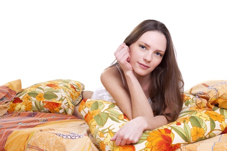 Young woman lay on color pillow isolated portrait Stock Photo - 9070067
