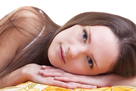 Young woman lay on color pillow slose-up portrait Stock Photo - 9070041