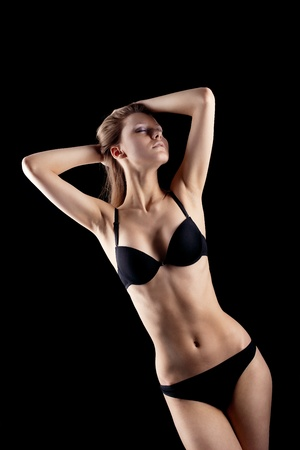 Young beauty blond girl in black lingerie Stock Photo - 9069982