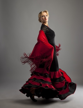 gypsy woman: Beauty woman dance flamenco in black and red costume