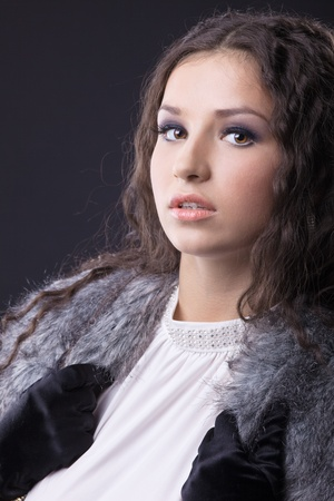 Beauty sensual girl close-up portrait in fur coat look at you photo
