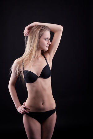 Young blond girl with long hair in lingerie Stock Photo - 9181212