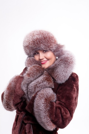 fur hood: Woman smile in winter fur coat isolated Stock Photo