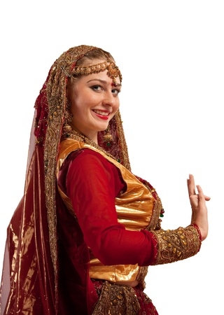 oriental ethnicity: Beauty woman in red oriental indian costume isolated Stock Photo