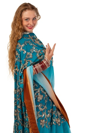 Young girl stand in blue traditional indian costume isolated photo