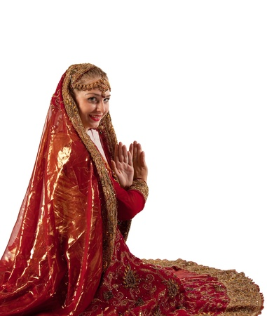 Beauty woman in red oriental indian costume isolated photo