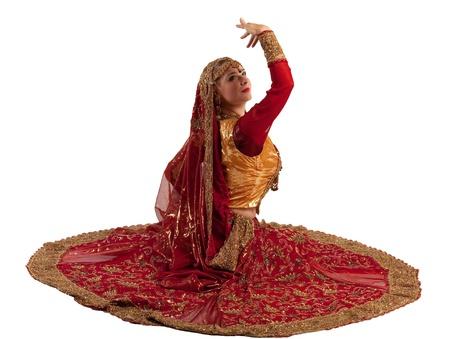 bollywood: Schoonheid vrouw in rode Oosterse Indiase kostuum geïsoleerd Stockfoto