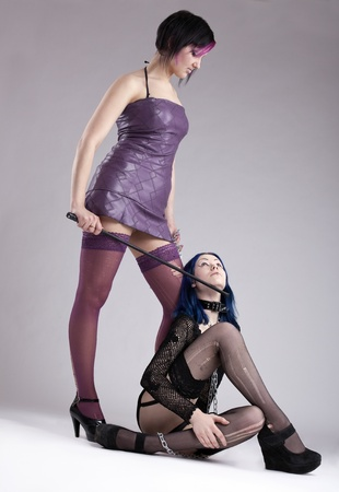 Two girls play bdsm games - slavery position Stock Photo - 9213025