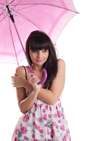 beauty woman freeze under rose umbrella in summer dress isolated photo