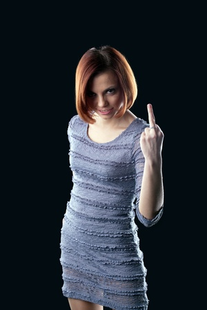 Young aggressive brunette with middle finger Stock Photo - 9257009