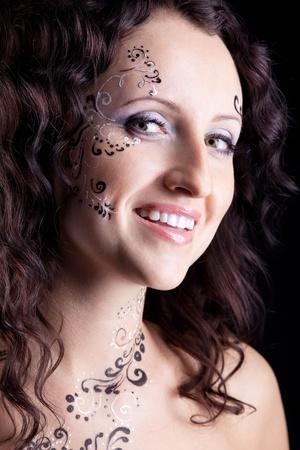 Beauty woman face with paint close-up portrait photo