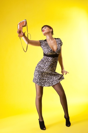 Sexy woman shoot herself on old-style camera - pin-up style Stock Photo - 9257020