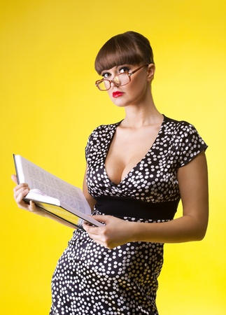 Beauty woman in attractive dress and glasses read smart book photo