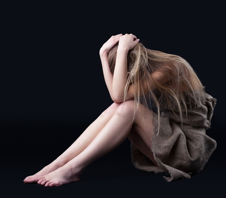 Beauty blond girl in rag close head in depression  Stock Photo