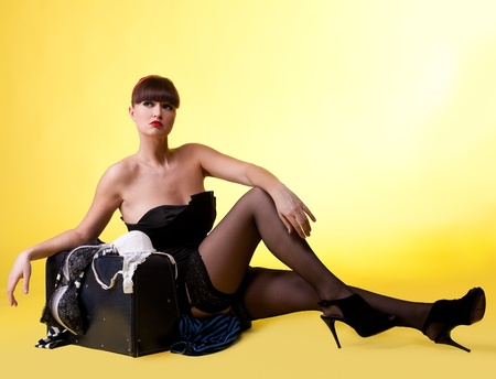 Sexy woman with broken baggage - pin-up style Stock Photo - 9391672