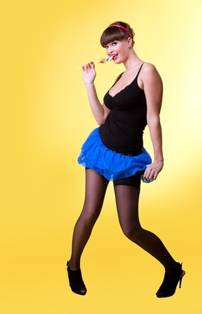 Beauty sexy woman with candy pinup style smile to you photo