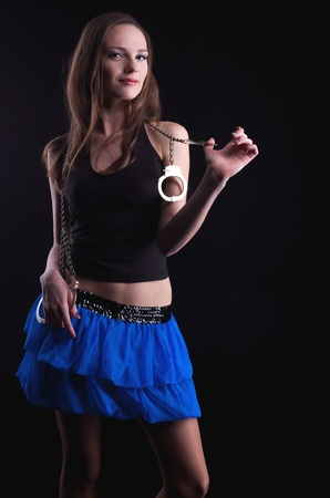 pretty young girl play with handcuff look at you photo