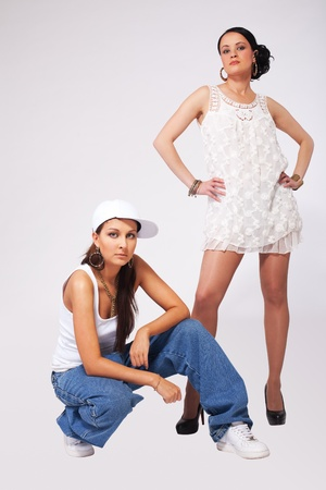 Two Young beauty girls posing in hip-hop style Stock Photo - 9409950