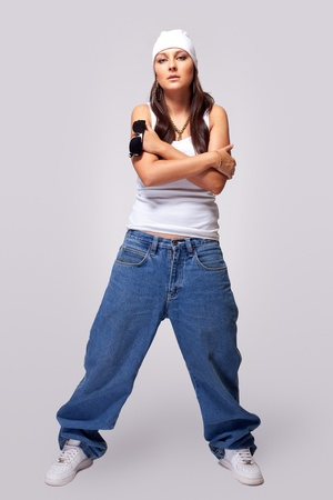 Young beauty tomboy stand in hip-hop style cloth photo