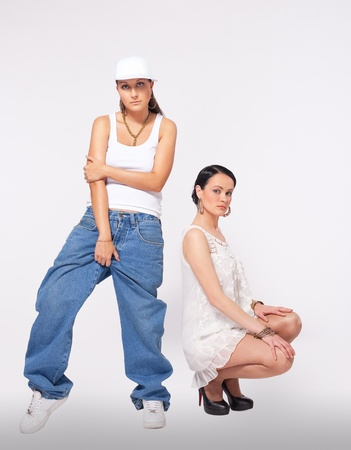 Two young woman posing and dance hip-hop style Stock Photo - 9409944