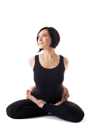 young woman training in yoga - lotos pose isolated photo