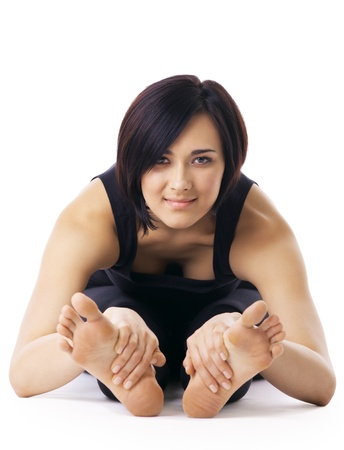 woman sit  in yoga asana - Seated Forward Bend isolated look at you Stock Photo - 9421126