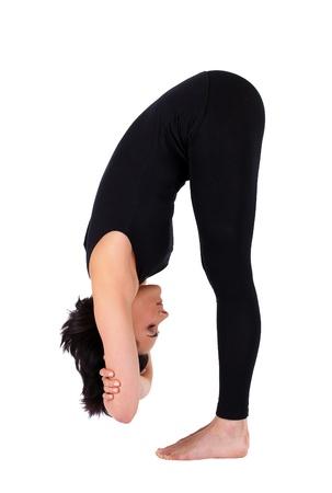young woman training in yoga - uttanasana stand pose  photo