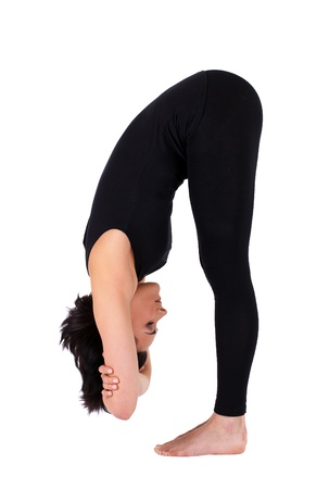 young woman training in yoga - uttanasana stand pose  photo